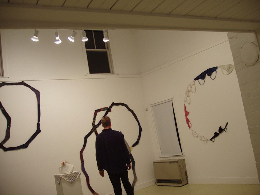 Installation with sock drawings